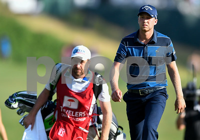 062517  Wesley Bunnell | Staff  Action from final day of the Travelers Championship on Sunday. Jordan Spieth would go on to hole out from the bunker on the first playoff hole against Dustin Berger to win the 2017 Travelers Championship. Dustin Berger and caddie walk towards the 18th green during the playoff hole.