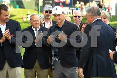 062517  Wesley Bunnell | Staff  Action from final day of the Travelers Championship on Sunday. Jordan Spieth would go on to hole out from the bunker on the first playoff hole against Dustin Berger to win the 2017 Travelers Championship. Jordan Spieth tries on his championship jacket.