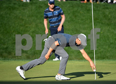 062517  Wesley Bunnell | Staff  Action from final day of the Travelers Championship on Sunday. Jordan Spieth would go on to hole out from the bunker on the first playoff hole against Dustin Berger to win the 2017 Travelers Championship. Jordan Spieth picks up his ball from the 18th hole after he would hole out from the sand trap.