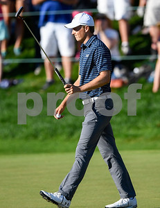 062517  Wesley Bunnell | Staff  Action from final day of the Travelers Championship on Sunday. Jordan Spieth would go on to hole out from the bunker on the first playoff hole against Dustin Berger to win the 2017 Travelers Championship. Jordan Spieth motions to the fans after finishing regulation before his playoff hole with Jordan Spieth.