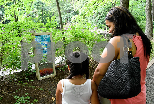 062317 Wesley Bunnell   Staff The Art League of New Britain along with the New Britain Youth Museum held an art show titled Summer Solstice Sculpture Walk on Friday June 23. Faith Morales, age 6, stands with mom Jaida Bolzanella in front of a piece titled Discared by Leona Clerkin.