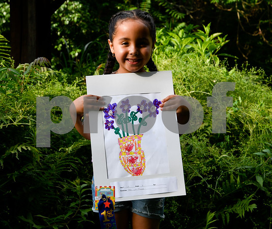 062317 Wesley Bunnell   Staff The Art League of New Britain along with the New Britain Youth Museum held an art show titled Summer Solstice Sculpture Walk on Friday June 23. Six year old Faith Morales holds up her artwork which took first place for the kIndergarten age group.