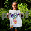 062317  Wesley Bunnell | Staff<br /> <br /> The Art League of New Britain along with the New Britain Youth Museum held an art show titled Summer Solstice Sculpture Walk on Friday June 23. Six year old Faith Morales holds up her artwork which took first place for the kIndergarten age group.