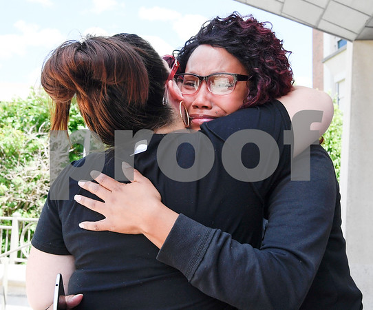 062617 Wesley Bunnell   Staff Natalie Torres was arraigned in New Britain Superior Court on Monday related to her accident this past Sunday with 15 year old Jose Alejandro while he was riding his bike. Torres is accused of driving under the influence. Jose Alejandro's step mother Nicole Jamieson, L, and Jose's mother Precious Prebon hug each other on the courthouse steps.