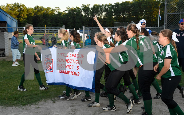 062617 Wesley Bunnell   Staff Bristol defeated Berlin on Monday evening in Plainville to claim the Little Leage District 5 Softball Championship. The Bristol team takes the banner for a victory lap around the field.