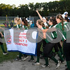 062617  Wesley Bunnell | Staff<br /> <br /> Bristol defeated Berlin on Monday evening in Plainville to claim the Little Leage District 5 Softball Championship. The Bristol team takes the banner for a victory lap around the field.