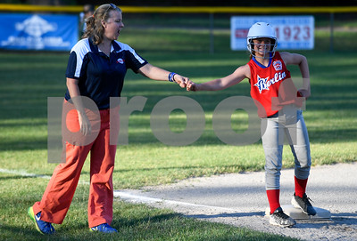 062617  Wesley Bunnell | Staff  Bristol defeated Berlin on Monday evening in Plainville to claim the Little Leage District 5 Softball Championship. Berlin's Olivia Wojtosik (19) fist bumps coach Coach Cop after reaching third base.