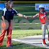 062617  Wesley Bunnell | Staff<br /> <br /> Bristol defeated Berlin on Monday evening in Plainville to claim the Little Leage District 5 Softball Championship. Berlin's Olivia Wojtosik (19) fist bumps coach Coach Cop after reaching third base.