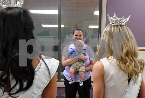 062617 Wesley Bunnell   Staff Healthtrax membership advisor Nicole Elliot holds her son Ryan, age 4 months, as newly crowned Miss CT Teen Brooke Eve Cyr, L, and Miss CT Eliza Lynne Kanner, stop to talk during a tour of Healthtrax in Bristol on Monday afternoon.