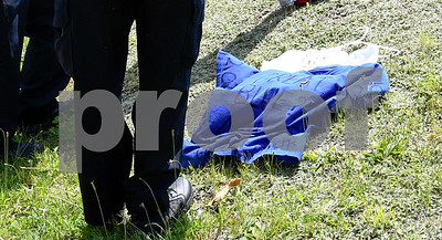 062817  Wesley Bunnell | Staff  A hate crime was reported by a resident of Arch St. on Wednesday afternoon when two shirts were left outside of a home referencing 9/11 along with anti Islamic language. The t-shirts lie on the ground at the feet of two responding officers.