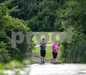 062817  Wesley Bunnell | Staff  Alex Louro, L,  and Melissa Cabral try their luck at fishing at Mill Pond Park on Wednesday afternoon.