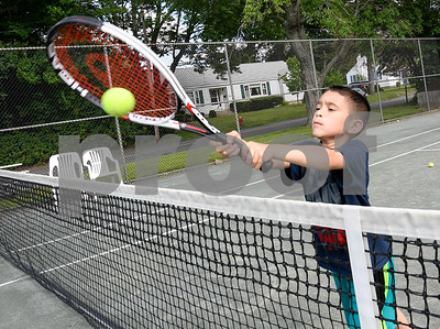 062817  Wesley Bunnell | Staff  7 year old Anthony Morales receives a tennis lesson from Bob Dean at Mill Pond Park in Newington on Wednesday afternoon.