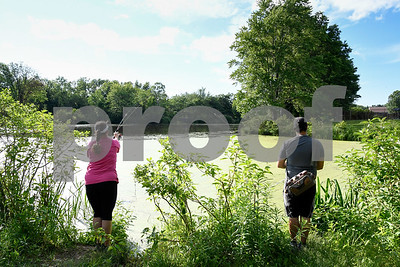 062817  Wesley Bunnell | Staff  Melissa Cabral, L,  and Alex Louro try their luck at fishing at Mill Pond Park on Wednesday afternoon.