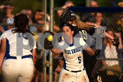 6/10/2017 Mike Orazzi | Staff Southington's Francesca Ferrante (5) and Kara Zazzaro (18) as Trumbull's Erica Fluskey (19) reaches first base during the Class LL softball final at West Haven High School Saturday night.