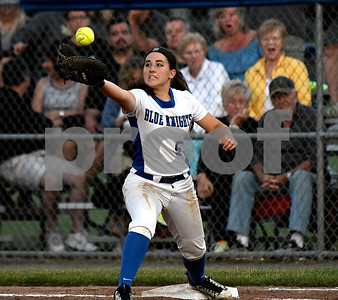 6/10/2017 Mike Orazzi | Staff Southington's Francesca Ferrante as Trumbull's Alexa Adinolfi (11) reaches first in the Class LL softball final at West Haven High School Saturday night.
