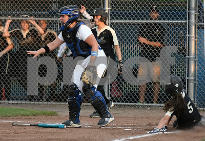 6/10/2017 Mike Orazzi | Staff Trumbull's Julia Huzi (5) scores during the Class LL softball final at West Haven High School Saturday night.