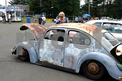 6/10/2017 Mike Orazzi | Staff Donna Green admires a Volkswagen Beetle during the Wings and Wheels Festival at Robertson Airport in Plainville Saturday.