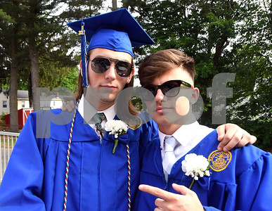 6/15/2017 Mike Orazzi | Staff Plainville High School graduates Jon Christy and Adnan Sadiku Thursday evening.