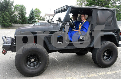 6/15/2017 Mike Orazzi | Staff Plainville High School graduates Tyler Rizzo and Devin Cook roll up to the Plainville High School graduation ceremony in Rizzo's 1998 Jeep TJ Thursday evening.