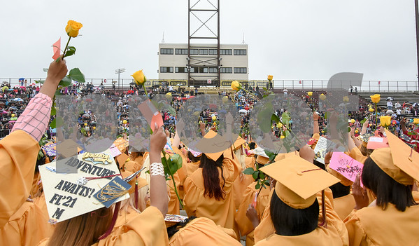 061617 Wesley Bunnell | Staff New Britain High School held graduation exercises on Friday afternoon outdoors at Veterans' Memorial Stadium despite intermittent rain showers.
