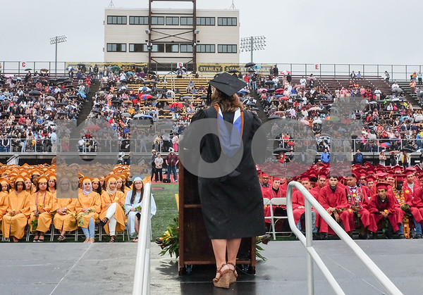 061617 Wesley Bunnell | Staff New Britain High School held graduation exercises on Friday afternoon outdoors at Veterans' Memorial Stadium despite intermittent rain showers. Mayor Erin Stewart addresses the crowd.
