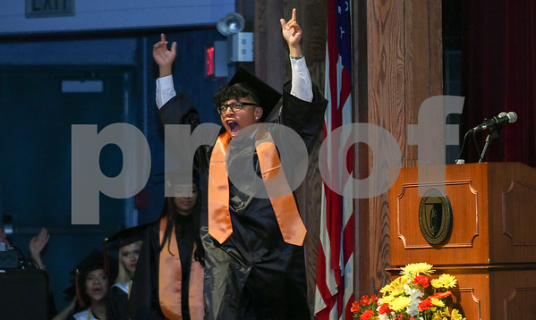 061617 Wesley Bunnell | Staff E.C. Goodwin Technical High School held their commencement ceremony on Friday evening at CCSU's Welte Hall. Austin Lopez celebrates as he walks onstage to receive his diploma.