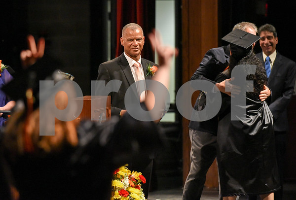 061617 Wesley Bunnell | Staff E.C. Goodwin Technical High School held their commencement ceremony on Friday evening at CCSU's Welte Hall. Principal Daniel Mello can be seen in the background as a student holds up her hands in celebration as she walks onstage.
