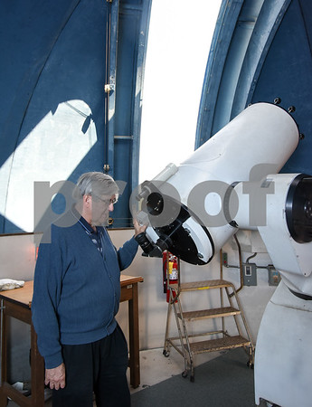 061617 Wesley Bunnell | Staff CCSU Planetarium Director Craig Robinson next to the telescope inside of the observatory on top of Copernicus Hall.