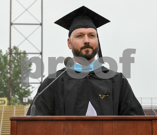 061617 Wesley Bunnell | Staff New Britain High School held graduation exercises on Friday afternoon outdoors at Veterans' Memorial Stadium despite intermittent rain showers. Principal Joseph Pinchera.