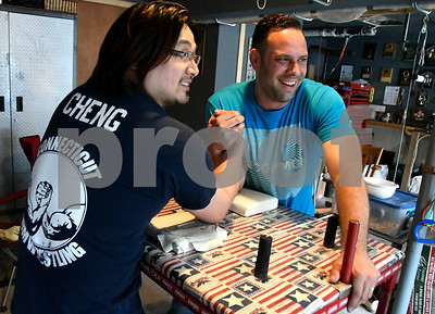 6/16/2017 Mike Orazzi | Staff Danny Cheng and Judah Thomas while practicing arm wrestling in Southington Friday.