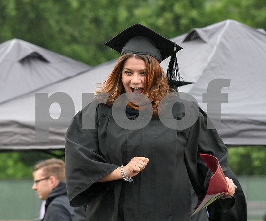 061617 Wesley Bunnell | Staff New Britain High School held graduation exercises on Friday afternoon outdoors at Veterans' Memorial Stadium despite intermittent rain showers. Mayor Erin Stewart is introduced.