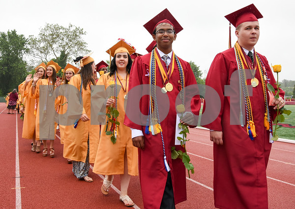 061617 Wesley Bunnell | Staff New Britain High School held graduation exercises on Friday afternoon outdoors at Veterans' Memorial Stadium despite intermittent rain showers. Valedictorian Saimum Habib and Salutatorian Joseph Jeffrey Bechard.