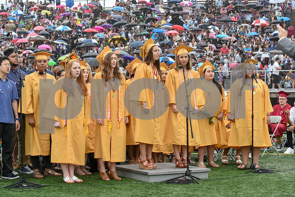 061617 Wesley Bunnell | Staff New Britain High School held graduation exercises on Friday afternoon outdoors at Veterans' Memorial Stadium despite intermittent rain showers. The concert choir performs In My Life.