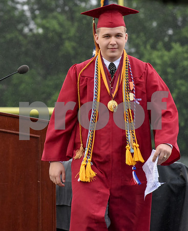 061617 Wesley Bunnell | Staff New Britain High School held graduation exercises on Friday afternoon outdoors at Veterans' Memorial Stadium despite intermittent rain showers. Salutatorian Joseph Jeffrey Bechard walks off stage.