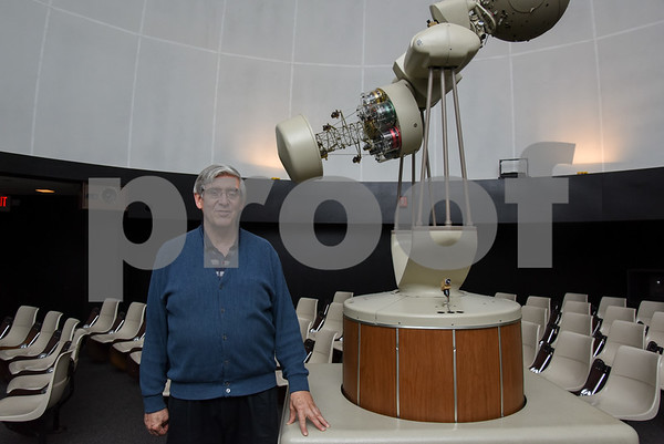 061617 Wesley Bunnell | Staff CCSU Planetarium Director Craig Robinson stands in the center of the planetarium inside of Copernicus Hall. Next to Robinson is the projector nicknamed Nick in reference to astronomer Nicolaus Copernicus