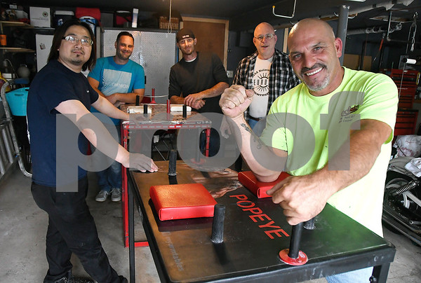 6/16/2017 Mike Orazzi | Staff Ron Ermini (right) with some of his arm wrestling team members, left to right: Danny Cheng, Judah Thomas, Marc Piatek and Bob Paradis.