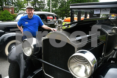 6/17/2017 Mike Orazzi | Staff Wil Hevey looks over a 1928 Packard 526 during the Klingberg Vintage Motorcar Festival in New Britain Saturday morning.