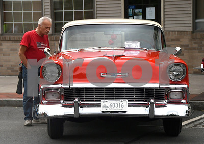 6/17/2017 Mike Orazzi | Staff Rick Herbert looks over a 1956 Chevy during The 8th Annual Bill Englert Memorial Auto Show held on North Main Street in Bristol Saturday.