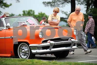 6/17/2017 Mike Orazzi | Staff Dee and Walt Holliday admire a 1953 Mercury on display during the Klingberg Vintage Motorcar Festival in New Britain Saturday morning.