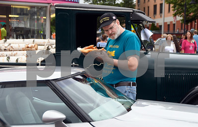 6/17/2017 Mike Orazzi | Staff Wayne Spargo eats a fried dough during The 8th Annual Bill Englert Memorial Auto Show held on North Main Street in Bristol Saturday.