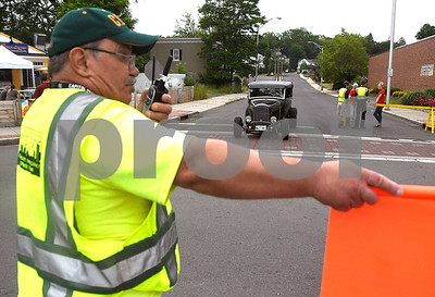 6/17/2017 Mike Orazzi | Staff Sam Alkas directs cars during The 8th Annual Bill Englert Memorial Auto Show held on North Main Street in Bristol Saturday.
