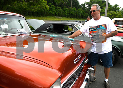 6/17/2017 Mike Orazzi | Staff Tom Williams wipes down his 55 Chevy during The 8th Annual Bill Englert Memorial Auto Show held on North Main Street in Bristol Saturday.