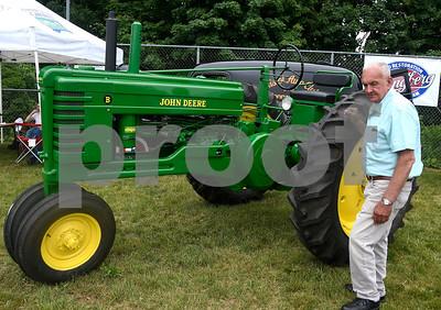 6/17/2017 Mike Orazzi | Staff Pete Germini next a John Deere Model B on display during the Klingberg Vintage Motorcar Festival in New Britain Saturday morning.