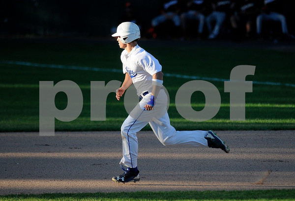6/20/2017 Mike Orazzi | Staff Bristol Blues' Mark Tumosa (6) on his way to second base at Muzzy Field Tuesday night.