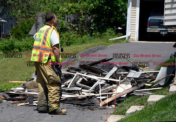 6/2/2017 Mike Orazzi | Staff Town of Plymouth Fire Marshal Ray Kovaleski on scene of house fire at on Main Street Friday.