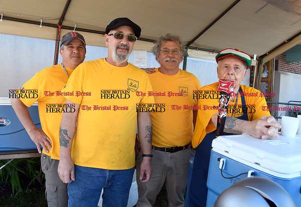 6/1/2017 Mike Orazzi | Staff Dave DelGiudice, Dan Valerio Jr., Don Palaia and Joe Caminiti at the beer tent during the St. Anthonys Italian Festival Friday evening.