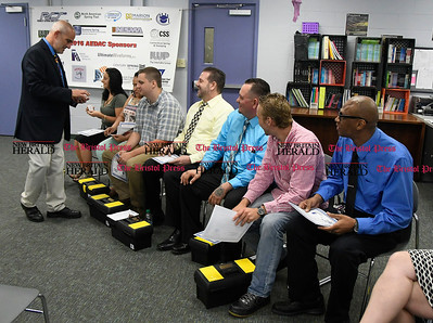 6/2/2017 MIke Orazzi | Staff Bristol Adult Education Supervisor Larry Covino passes out $25 gas cards to Bristol Workforce Development graduates during Friday morning's graduation ceremony at the Bristol Adult Education.