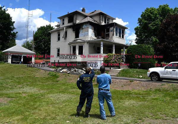 6/2/2017 Mike Orazzi | Staff Town of Plymouth Deputy Fire Marshall Charlie Doback and town building inspector Clarence Atkinson on scene of house fire at on Main Street Friday.