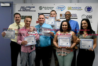 6/2/2017 MIke Orazzi | Staff Bristol Workforce Development graduates during Friday morning's graduation ceremony at the Bristol Adult Education. Left to right: Glenn Fortier, Jose Rodriguez, Michael McLaughlin, Evan Corriveau, Elizabeth Correa, Patrick Singleton and Dawn Pearson.