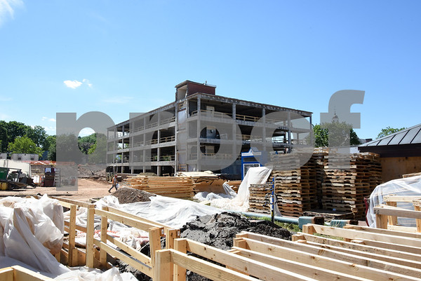 062217 Wesley Bunnell | Staff Construction continues on the $62M Willard & DiLoreto project at CCSU on Thursday afternoon. Willard Hall behind construction material.